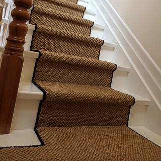 Natural Rustic Sisal With Black Overlocking On Stairs